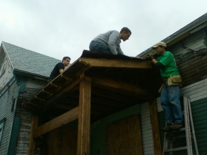 Reclaimed roof decking and new asphalt shingle installation